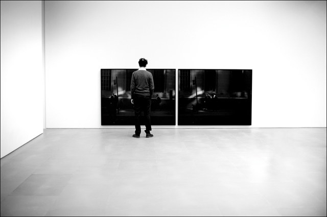 Paul Graham in front of a diptych from the serie The Present